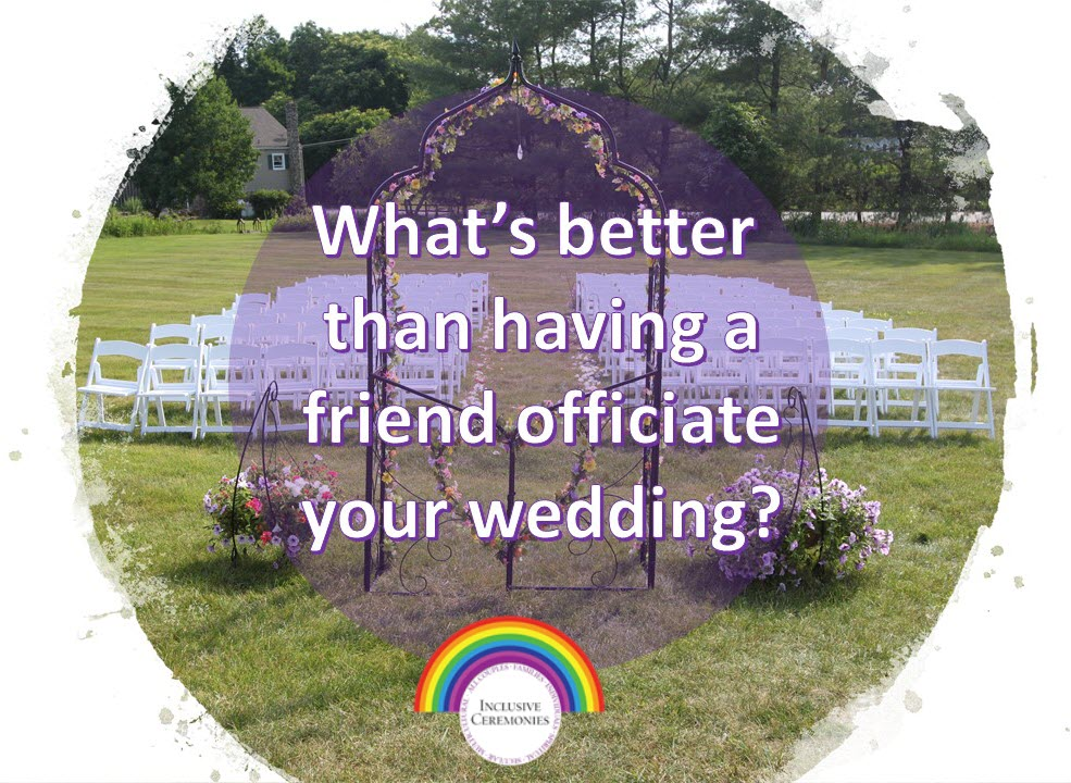 An arch decorated with flowers stands before rows of white chairs in field, set up for a wedding ceremony.